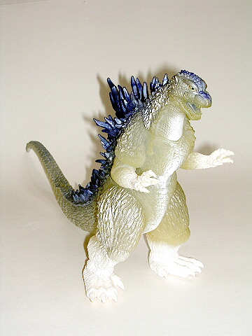 Beautiful Frost White with deep blue fins. This godzilla is from the Toho Movie Godzilla vs Mechagodzilla 2003. Made of Vinyl, it stands approximately 8 ½ inches tall and 15 ½ inches long. Mint Condition figure with Attached Tag. GORGEOUS!! (limited supply available) This is one of the MOST IMPRESSIVE THEATER EXCLUSIVE GODZILLA FIGURES EVER MADE!!